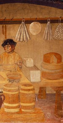 Freski z XV wieku, do dziś obecne na zamku w Issogne, przedstawiające okrągłe formy sera Fontina.